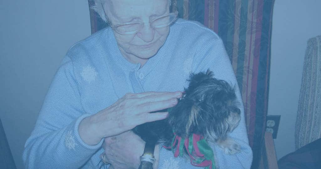 Photo of Marianhill resident hugging a lap dog