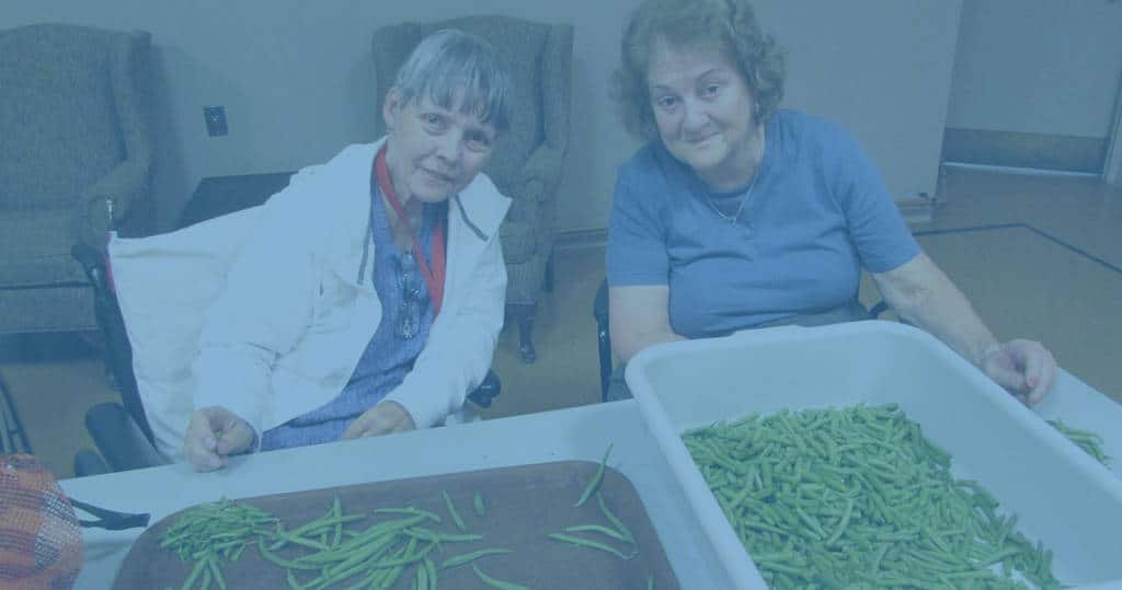 Photo of two women prepping green beans