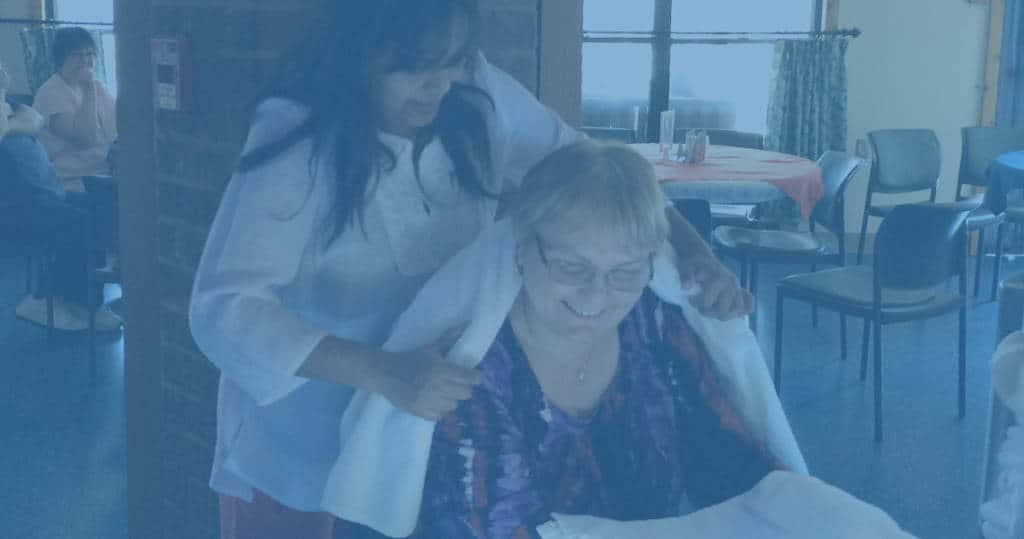 Photo of Marianhill personal support worker wrapping a resident in a blanket