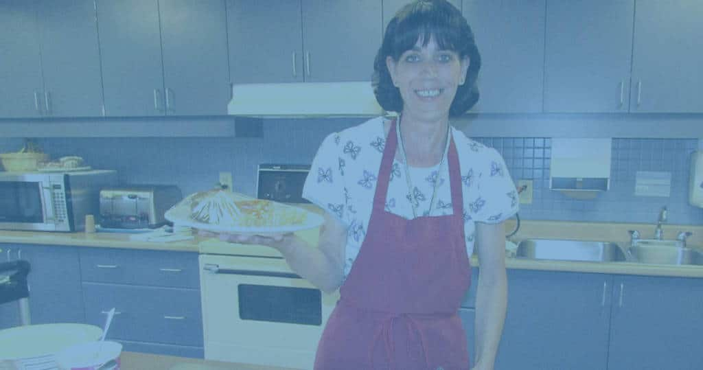 Photo of Marianhill kitchen staff member holding plate of food
