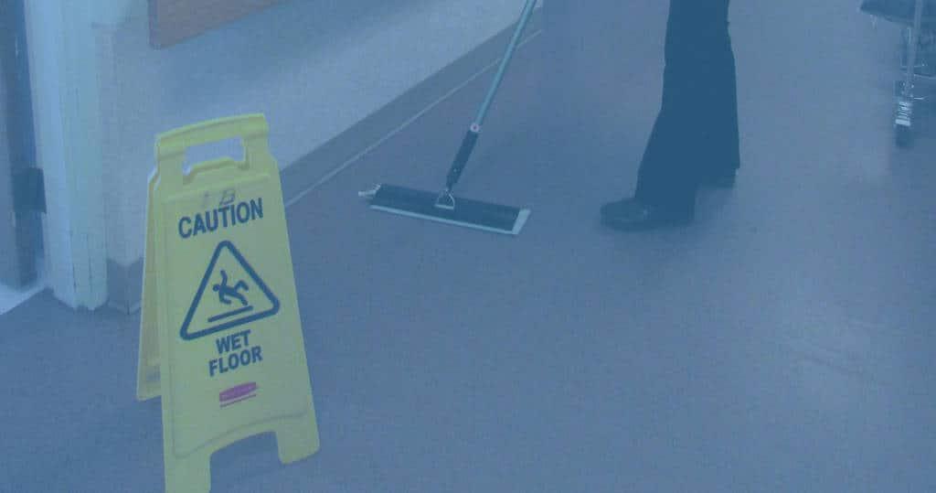 Closeup photo of caution wet floor sign