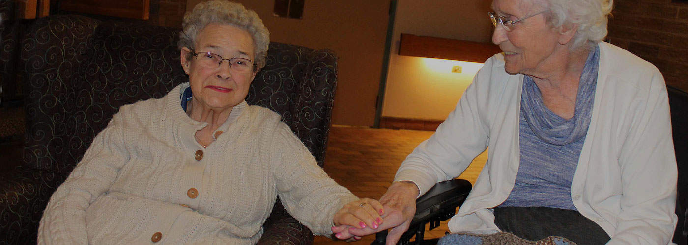 Photo of two elderly women sitting together in Marianhill lounge