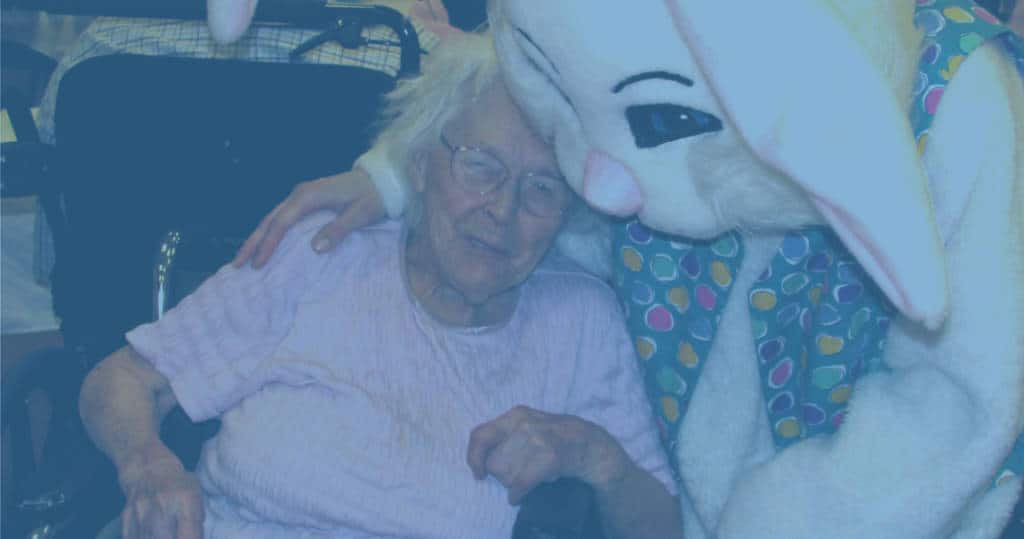 photo of bunny mascot hugging a Marianhill resident