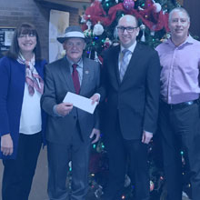 photo of rod sinclair making a donation to marianhill; accepting a cheque are linda tracey, hec clouthier and glenn casey
